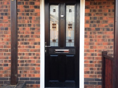 composite door with patterned window