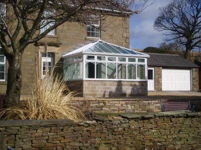 White pvc Edwardian stone built conservatory