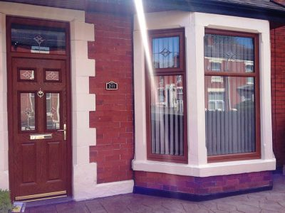 upvc windows in wood effect square bay