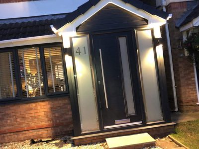 illuminated black and frosted glass porch