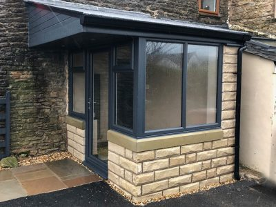 stone effect and black frame porch from Porch builders RTE